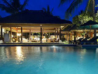Ombak Laut - Pool and living room at night